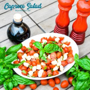 Caprese Salad is a simple fresh tomato salad recipe made with fresh tomatoes, basil, and mozzarella with balsamic vinegar and olive oil for a quick and easy side dish all summer long.