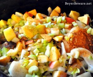 The flavors of fall are melded together in these crock pot apple pork chops. As the pork chops slow cook on top of cornbread stuffing, dinner is complete.