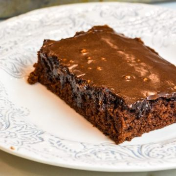 Grandma's Texas Sheet Cake is a tried and true chocolate sheet cake recipe with all the cocoa and butter in the recipe to make it so outrageously delicious.