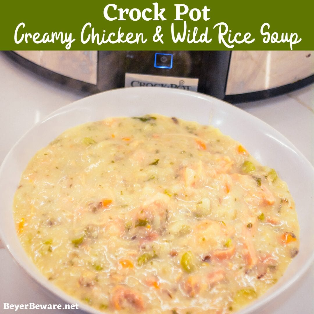 Crock pot creamy chicken and wild rice soup is slow-cooked all day in a base of carrots, celery, onions, and garlic and then made creamy with a simple white sauce to quickly become your family\'s favorite hearty soup recipe.