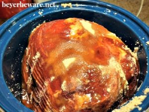 Ham slow cooked in a crock pot is juicy and the brown sugar, maple syrup and pineapple juice this crock pot maple ham is cooked in leaves it full of flavor.