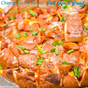 The cheesy ranch bacon pull-apart bread recipe is an easy appetizer made with a Hawaiian Bread round loaf that is filled with bacon, cheese, and, green onions ranch butter then baked to gooey crack bread perfection.