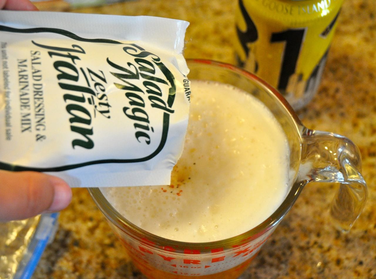 Pouring Italian seasoning into beer