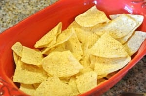 Tortilla chips on the bottom of a casserole dish