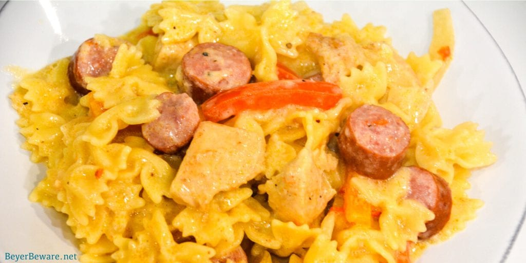 This Cajun chicken and smoked sausage pasta recipe is a quick and easy weeknight dinner since it is made in under 30 minutes and requires opening a bottle of wine.