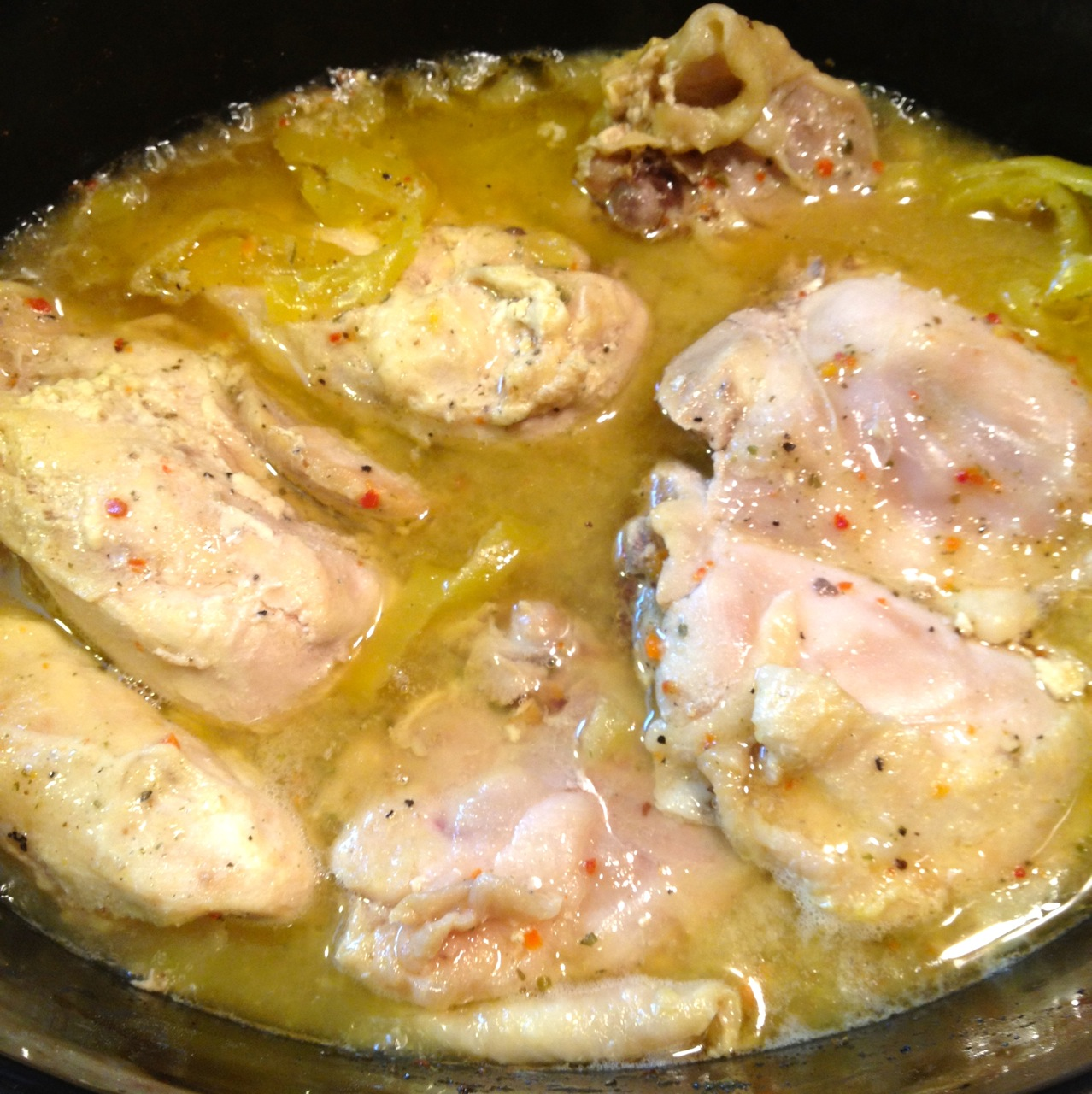 Cooked pieces of Italian Chicken in the crock pot