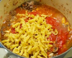 uncooked pasta, tomato sauce and seasoning for Speedy Skillet Lasagna.