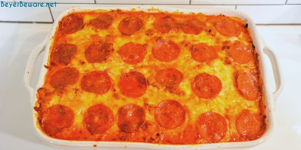 Bubble-Up pizza casserole is an easy weeknight meal since the casserole is made with grands biscuits, spaghetti sauce and your favorite pizza toppings.