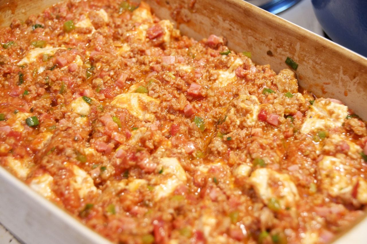 Bubble Pizza Casserole spread into pan