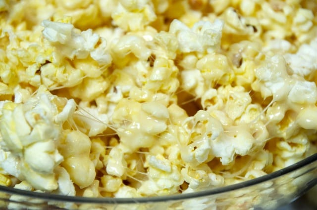Ooey-Gooey Popcorn Recipe - This is sticky and sweet and salt and in no way fits into any weight loss diet. Ooey-Gooey Popcorn is made with marshmallow cream, theater popcorn, and more butter!