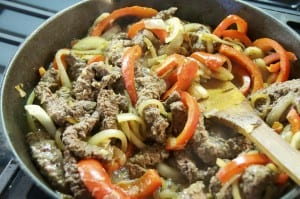 sliced cubed steak in onions and peppers