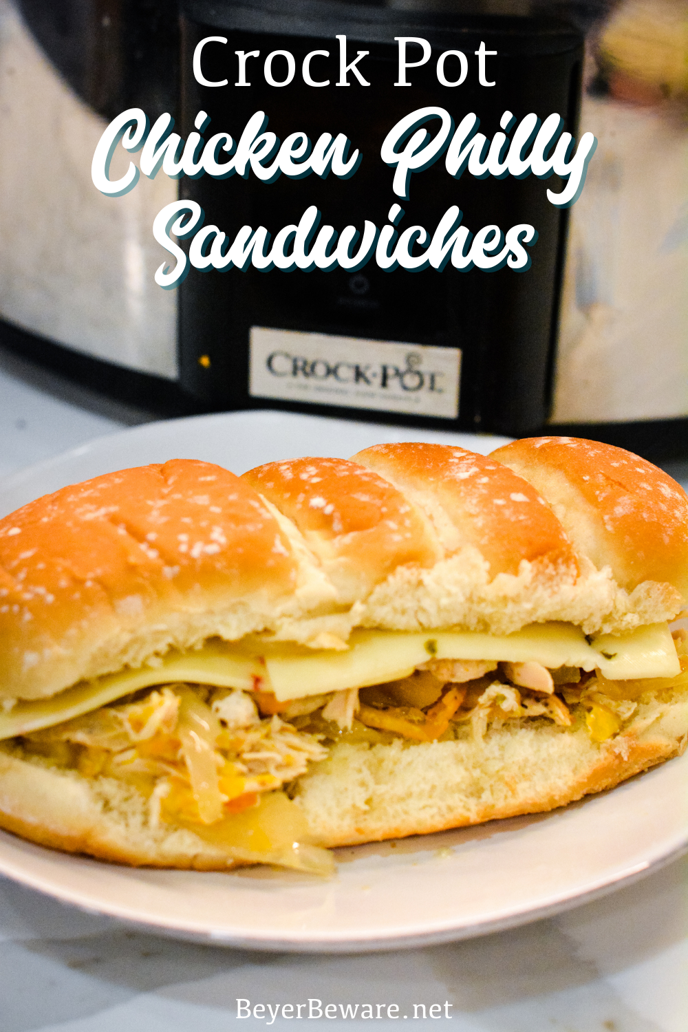 Crock pot chicken philly sandwiches are an easy pulled chicken sandwiches made with onion, peppers, chicken, steak seasoning, and butter.
