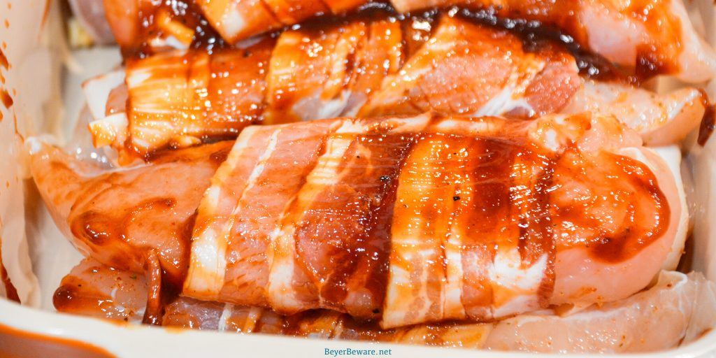 Grilled bacon-wrapped BBQ chicken recipe is lightly seasoned chicken tenderloins that are then wrapped in bacon and then coated in a doctored up barbeque sauce before quickly grilling to perfection.
