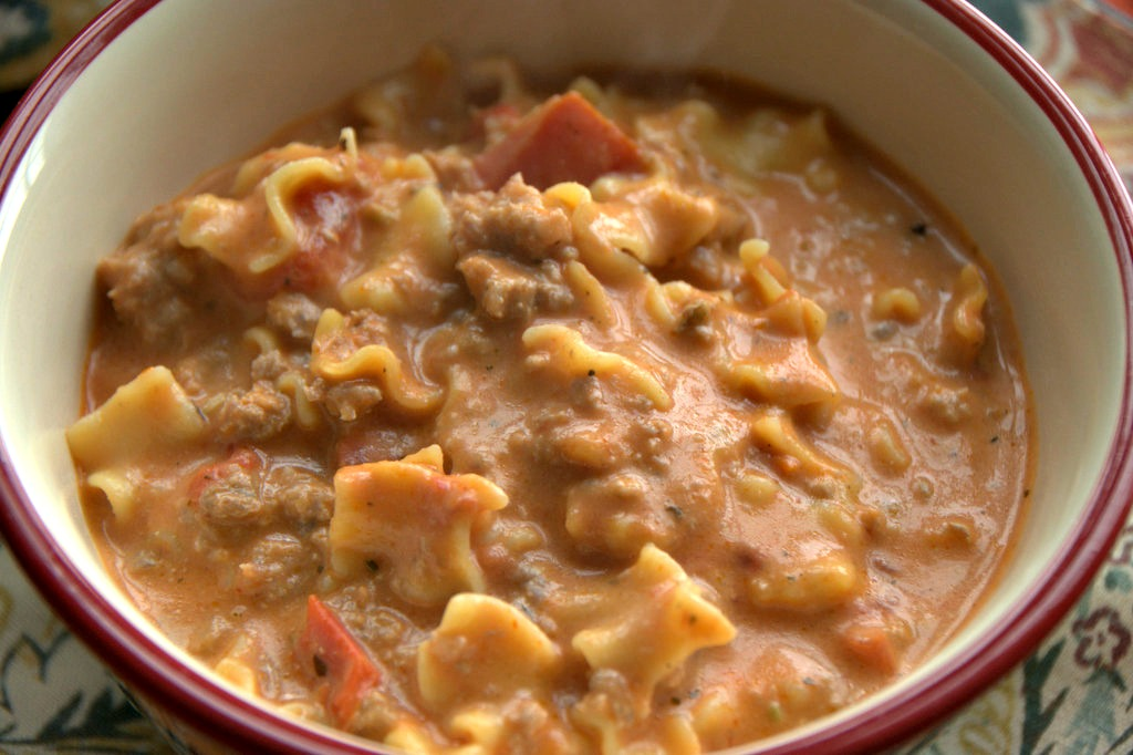 Creamy Italian Sausage Soup is a twist on chili or lasagna soup. Robust tomato and pork sausage flavor come together in this easy soup recipe. Plus easily low carb and gluten free with the omission of the pasta. #soup #ItalianRecipes #QuickRecipes #EasyRecipes