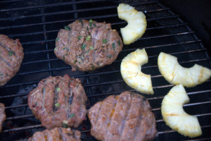 This grilled pineapple pork burger recipe gives an Asian zip to a farm staple, pork burger.