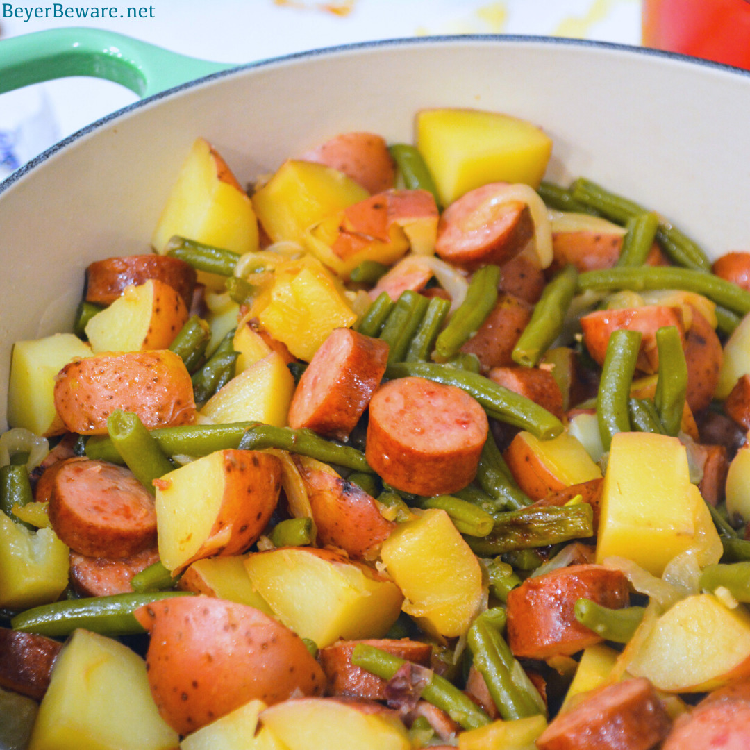 Hoosier Stew is Indiana comfort food with fresh green beans, red potatoes, and smoked sausage that has simmered in caramelized onions and garlic for an easy dinner recipe.