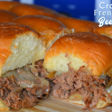 Crock Pot French onion shredded beef sliders recipe is a shredded French onion beef roast made with canned French onion soup, onions, butter and beef broth used to make cheesy sliders on Hawaiian rolls.