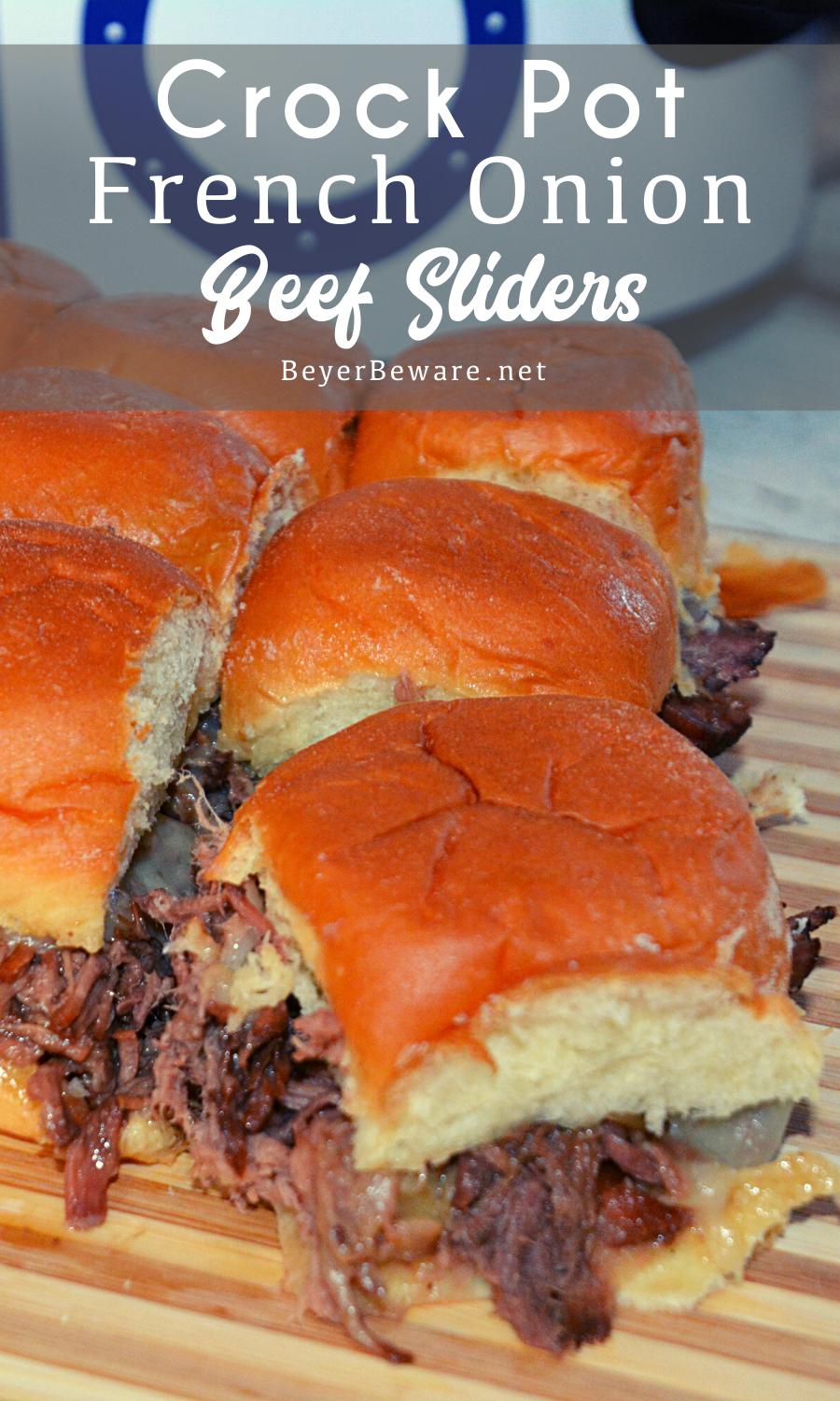 Crock Pot French onion beef sliders recipe is a shredded French onion beef roast made with canned French onion soup, onions, butter and beef broth used to make cheesy sliders on Hawaiian rolls.
