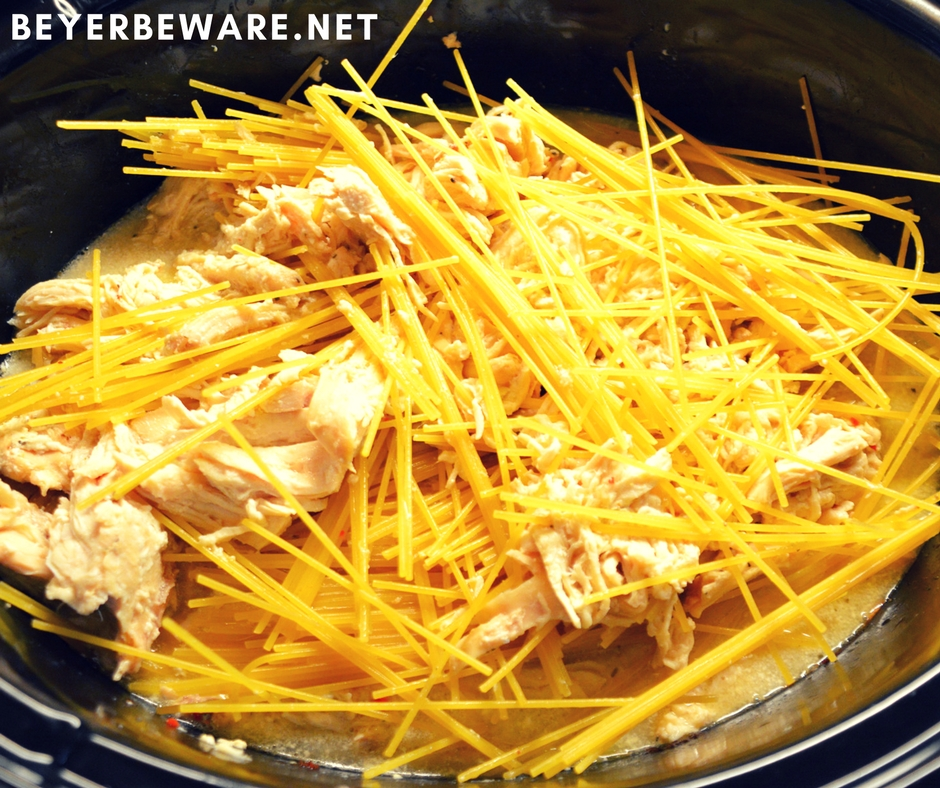 Crock pot creamy chicken spaghetti is the perfect chicken pasta dish with cream cheese and Italian seasoning to give the dish great alfredo flavors when you are needing to feed a large crowd or a hungry family.
