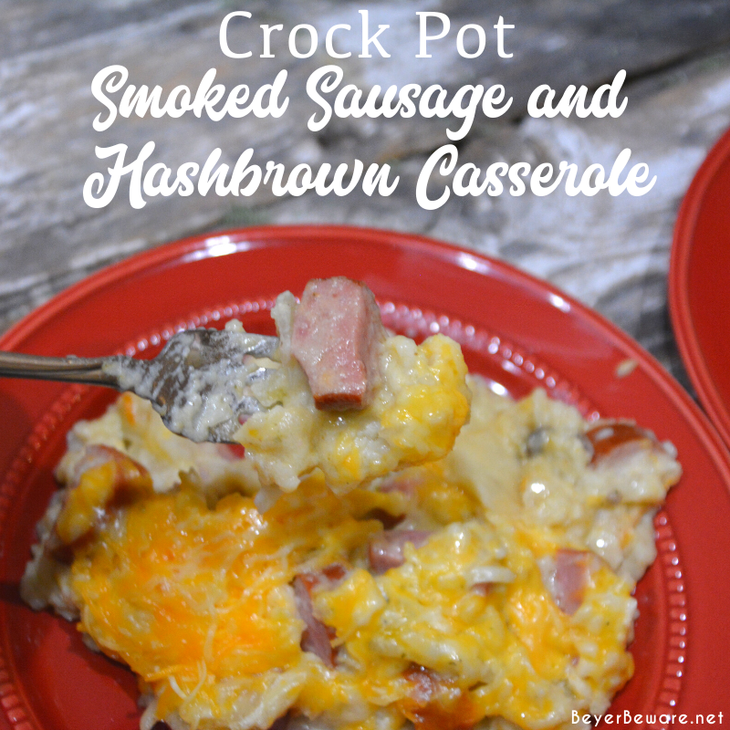 Crockpot smoked sausage and hashbrown casserole is a simple cheesy sausage and potato recipe made with frozen hash browns, sour cream, onions, cream of mushroom soup, smoked sausage, and shredded cheese that is a great weeknight meal in my beloved casserole crock pot.