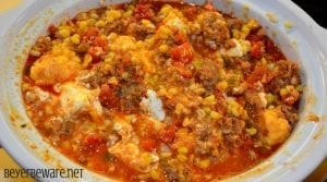 This crock pot corn and sausage queso dip is spicy from the addition of chorizo with a hint of sweet from the corn sure to make it your new favorite cheese queso dip recipe.