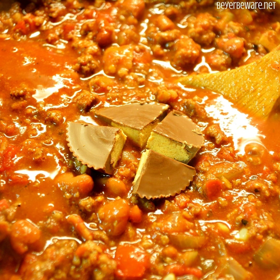 Reese's Peanut Butter Cup Chili combines bacon and ground beef and pork with smoked chili seasonings, beans and the secret Reese's Peanut Butter Cup. #Chili #PeanutButter #Bacon #Beef #Pork #Soup #Stew