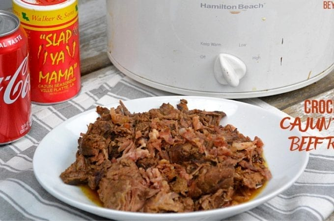 Crock Pot Cajun Bacon Beef Roast is full of Cajunflavors and smokiness from the bacon and bacon grease with tenderness brought on from a can of Coke. #PotRoast #CrockPot #Bacon #CajunRecipes #Beef