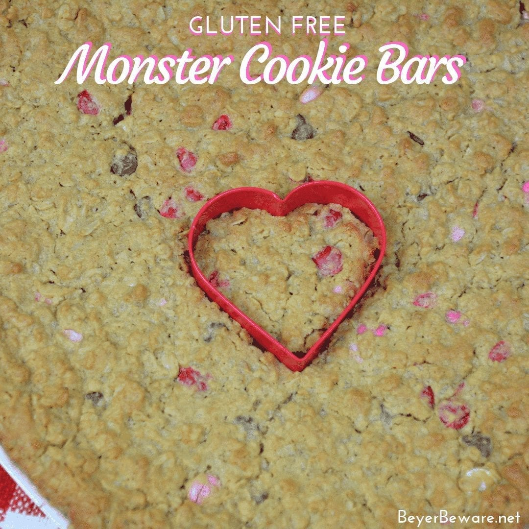 Gluten-Free Monster Cookie bars are a flourless bar cookie recipe combining peanut butter, oats, chocolate chips, and M & Ms to create a chewy chocolate cookie treat. #GlutenFree #Peanutbutter #Chocolate #GlutenFreeDessert #BarCookies