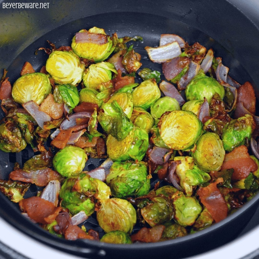 Ninja FoodiBrussels Sprouts, onions and bacon are a quick air fryer side dish that is the perfect Brussels Sprouts recipe. #NinjaFoodi #Airfryer #BrusselsSprouts #Bacon #EasyRecipes