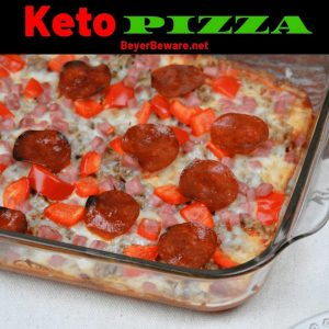 Keto pizza made with a cream cheese crust and topped with a thin layer of tomato sauce, your favorite toppings,and cheese. #Keto #LowCarb #Pizza #KetoPizza #LowCarbCrust