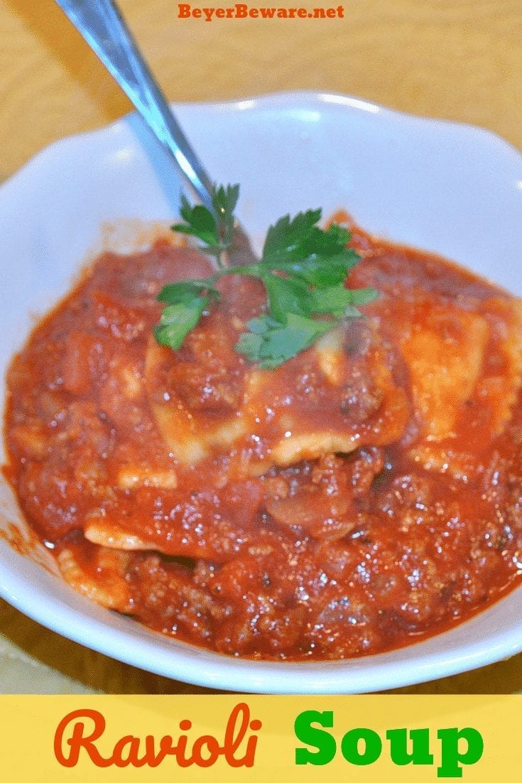 Meaty Tomato Ravioli Soup is a 30-minute meal combing ground beef, canned tomatoes, ravioli and parmesan cheese for a hearty and easy dinner recipe. #soup #Ravioli #EasyDinnerRecipe