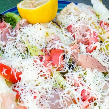 Grilled romaine salad topped with prosciutto, tomatoes, cheese and lemon juice & olive oil is the perfect BBQ side dish all summer long. #Salad #Grilling #lettuce #sidedish #Recipes
