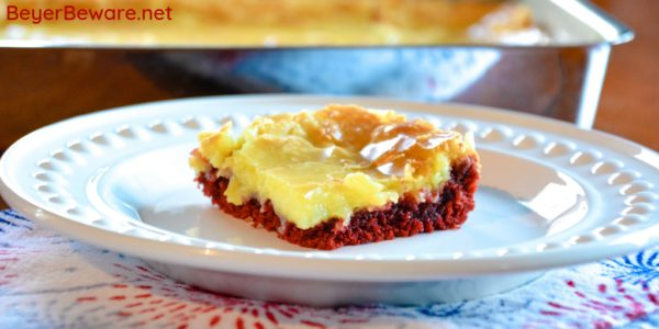 Red Velvet Ooey Gooey Butter Bars are a simple cake mix brownie baked with a cream cheese topping for your new favorite red velvet and cream cheese dessert. #RedVelvet #CakeMix #Dessert #Chocolate #Recipes
