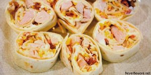 Chicken bacon ranch roll-ups are a quick tortilla wrap sandwich recipe sliced into pinwheels and filled with ranch cream cheese, chicken, bacon, and cheese.