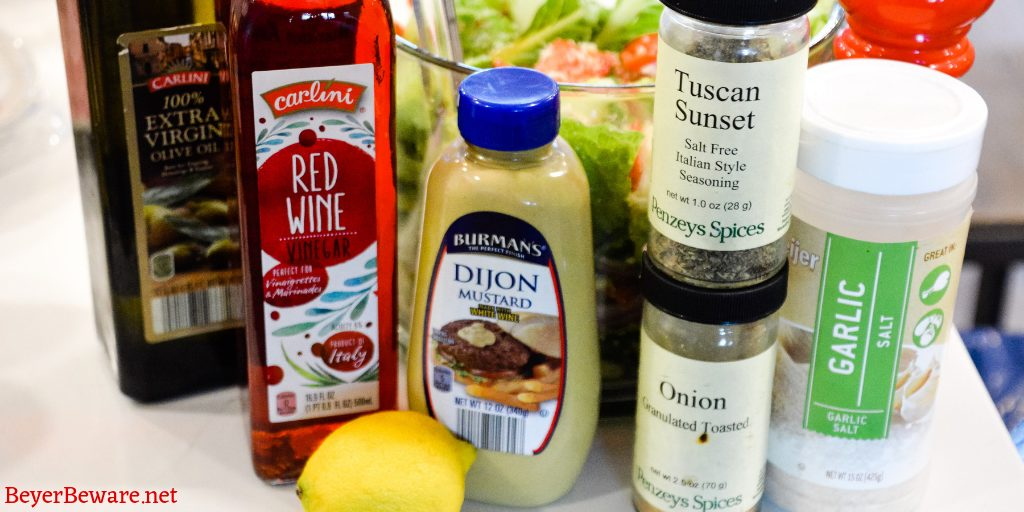 Homemade Italian Salad dressing combines simple tangy red wine vinegar and lemon juice with dijon mustard and olive oil with Italian herbs and seasonings for a simple homemade dressing recipe.