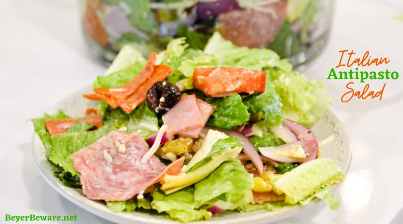 Italian antipasto salad is a hearty dinner salad with a romaine lettuce base and filled up with salami, pepperoni, tomatoes, cucumbers, onions, olives, banana peppers, and cheese dressed with a homemade Italian dressing.