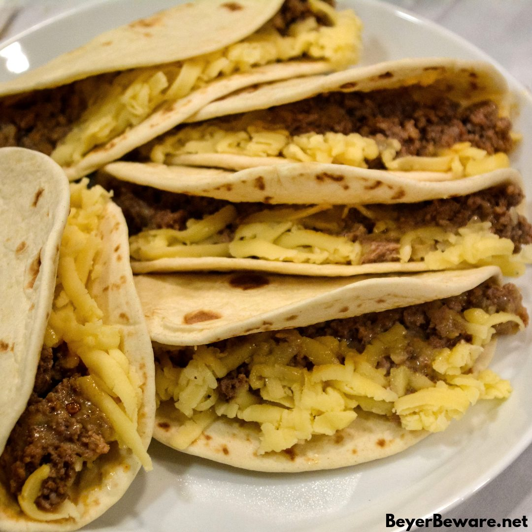 Air Fryer Mini Beef Tacos in the Ninja Foodi is an easy fried taco recipe made with taco seasoned hamburger, cheese and flour or corn tortilla shells. #Tacos #Airfryer #NinjaFoodi #Beef