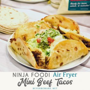 Air Fryer Mini Beef Tacos in the Ninja Foodi is an easy fried taco recipe made with taco seasoned hamburger, cheese and flour or corn tortilla shells.