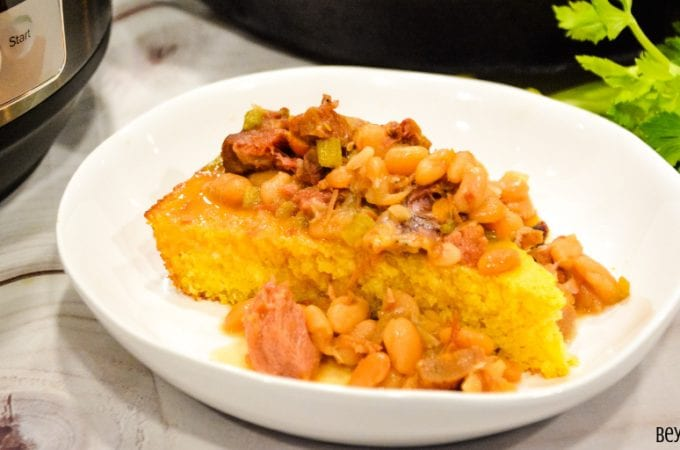 Instant Pot Ham and Beans served over freshly baked cornbread is the ultimate comfort food made in just a fraction of the time compared to a slow cooker.