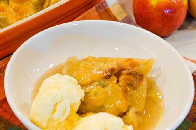 Super Easy 5-Ingredient Apple Dumplings are made with store-bought pie crusts, apples, cinnamon and sugar, butter, and a simple cinnamon and sugar syrup.