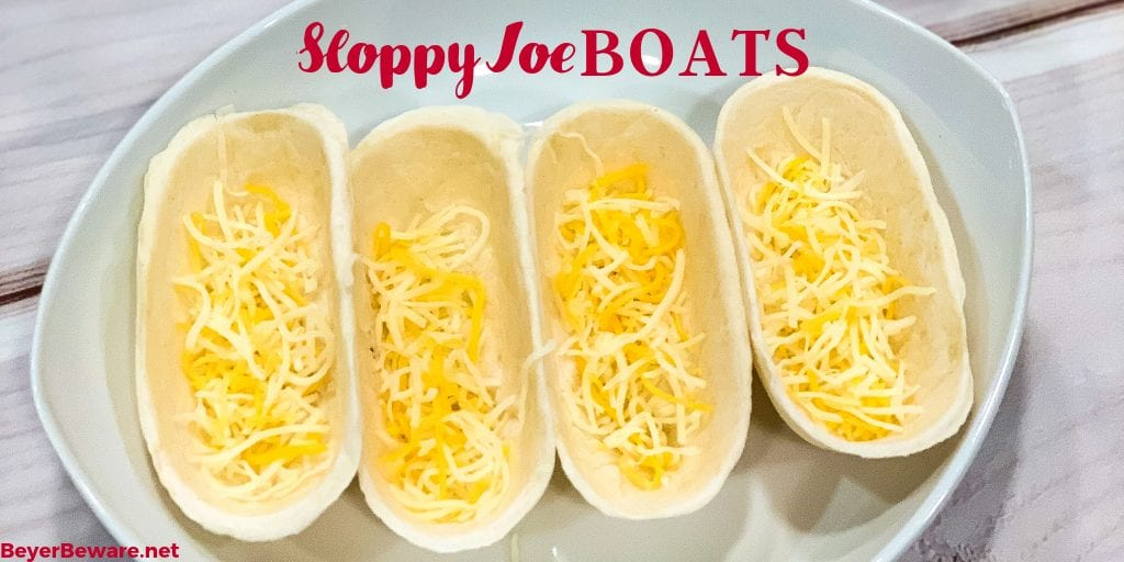 Sloppy Joe Boats is the easy way to eat your sloppy joe recipe without the mess by fill taco boat shells with sloppy joe and topping off with cheese.