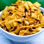 Caramel Cashew Chex Mix is a sweet caramel coated Chex and Golden Graham cereal mix that also includes the buttery and salty addition of cashews.