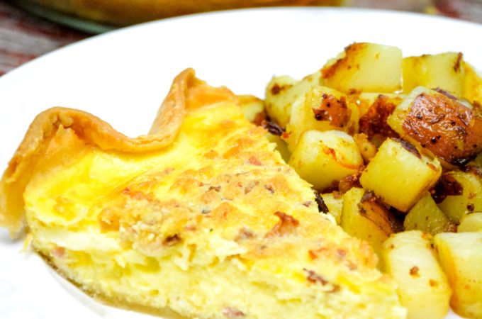 Easy bacon and cheese quiche is made quickly in a blender and poured into a store-bought pie crust that has been filled with bacon and shredded cheese for a velvety smooth quiche.