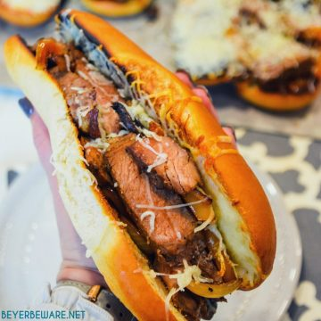 Leftover steak sandwiches uses up cooked steaks to create a midwest version of a Philly Cheesesteak sandwich with caramelized mushrooms, onions and peppers.