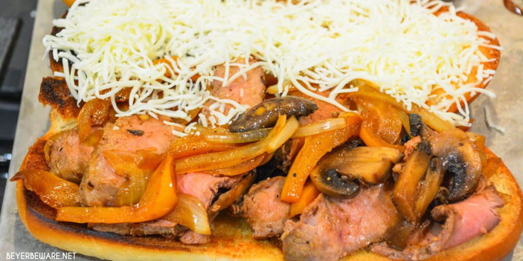 Leftover steak sandwiches uses up cooked steaks to create a midwest version of a Philly Cheesesteak sandwich with caramelized onions, mushrooms, and peppers.
