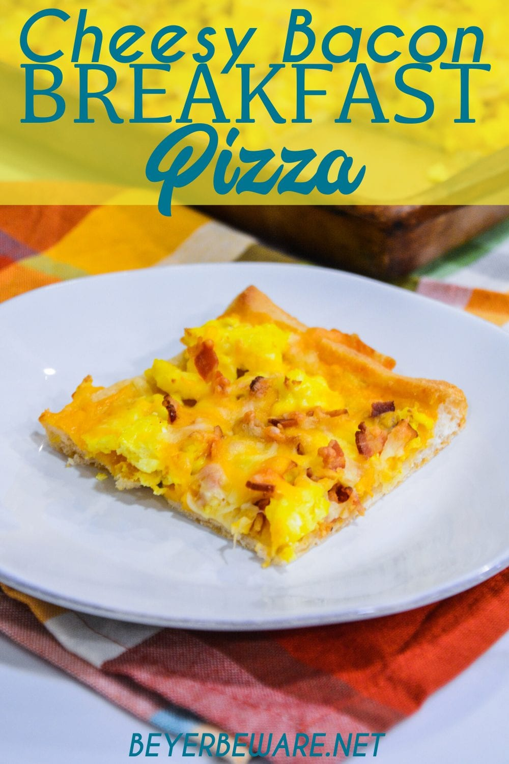Cheesy bacon breakfast pizza is made with a refrigerated pizza crust, cheese sauce, scrambled egg, and bacon, topped off with more cheese and garlic butter for a decadent breakfast treat.