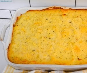 Cheesy Shepherd's Pie is a ground beef casserole filled with mixed vegetables, cheese, cream of mushroom soup, and topped off with mashed potatoes.