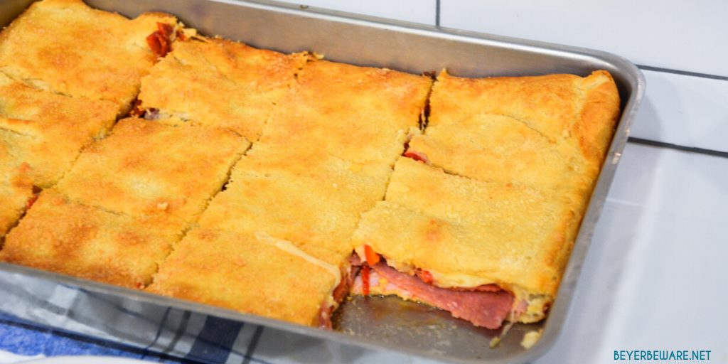 Italian squares are antipasto stuffed crescent rolls that are made with two sheets of a crescent roll dough, ham, salami, pepperoni, pepper rings, and cheese then baked to perfection.