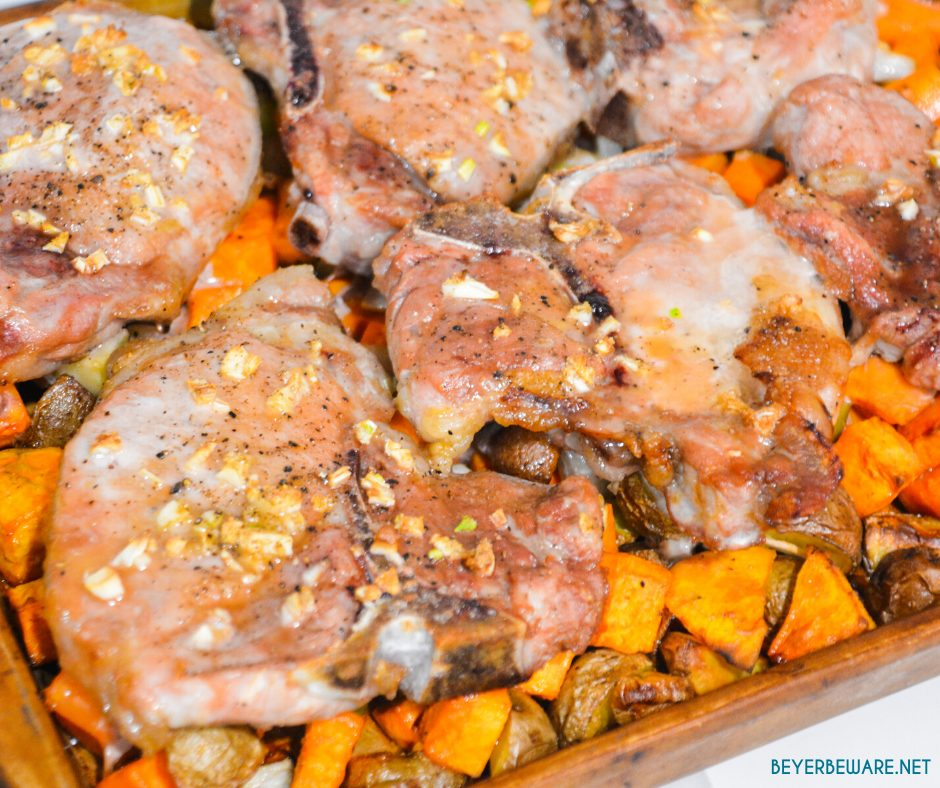 Sheet pan pork chops, sweet potatoes, and red potatoes are a garlic brown sugar pork chops recipe baked on top of roasted sweet potatoes and red potatoes.