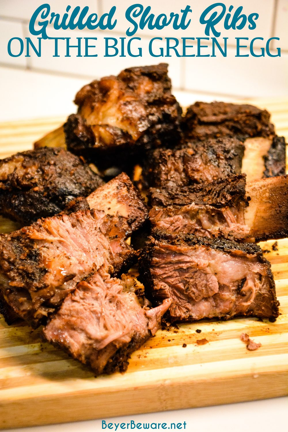 Grilled beef short ribs on the Big Green Egg are smoked with a beef barbecue rub and then slow-cooked to their final temperature in a bath of red wine, butter, and beef broth.